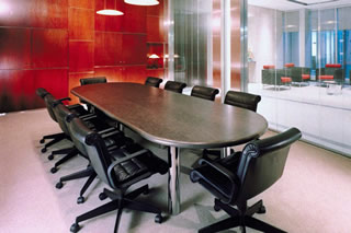 Business Black wood table with black leather chairs and woo - Insurance FAQ